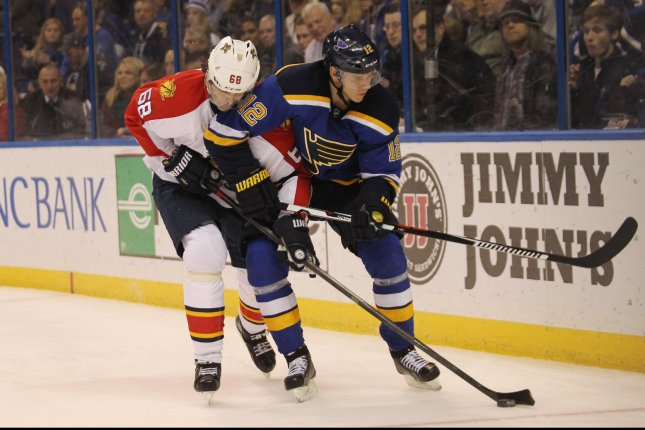 Florida Panthers' Jaromir Jagr and St. Louis Blues' Jori Lehtera. Photo by Bill Greenblatt/UPI