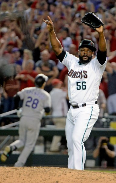 Free agent closer Fernando Rodney raises his arms in celebration as a member of the Arizona Diamondbacks after getting the last out in the National League Wildcard Game against the Colorado Rockies in October. Photo by Art Foxall/UPI