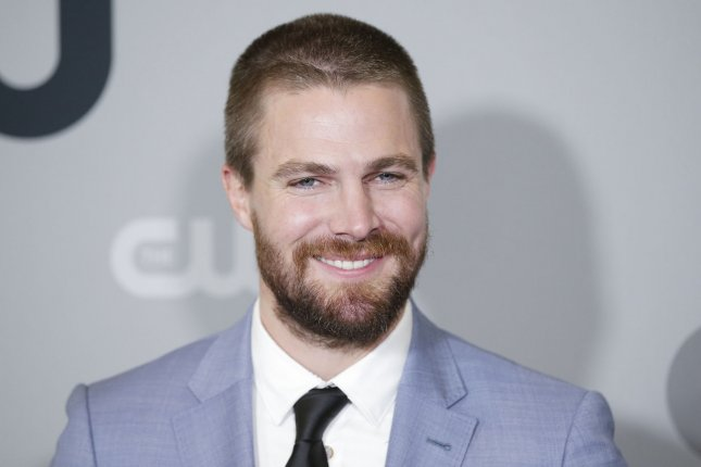 Arrow star Stephen Amell. Arrow will crossover with The Flash and Supergirl starting in December. File Photo by John Angelillo/UPI