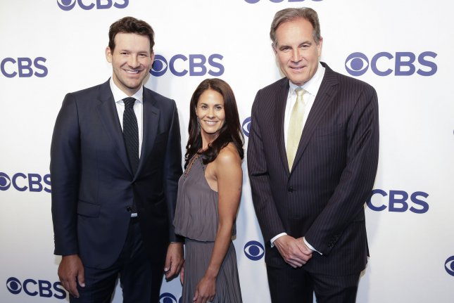 Tony Romo (L) now works alongside Tracy Wolfson and Jim Nantz as a CBS commentator. File Photo by John Angelillo/UPI