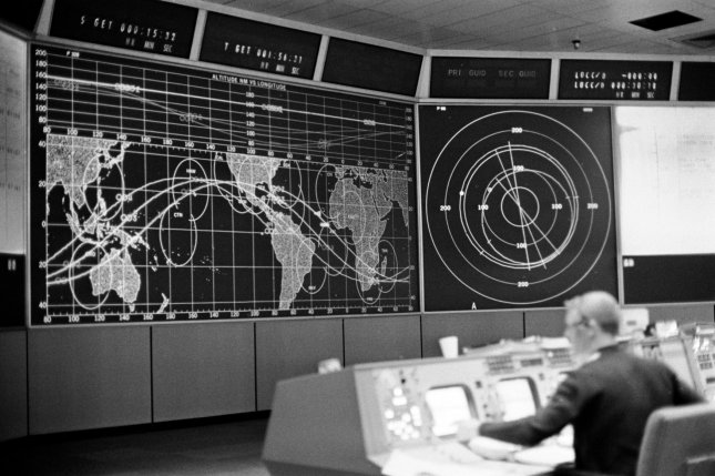 A view inside mission control at the Johnson Space Center in Houston, Texas, during NASA's Gemini 8 mission on March 16, 1966. The control centers were designed by longtime NASA pioneer Chris Kraft. UPI Photo/File
