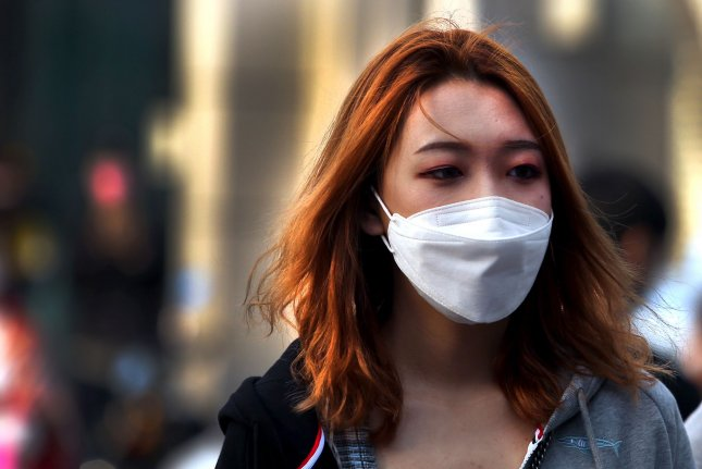 Chinese people continue to wear protective face masks outside even though the government has declared the threat of the Covid-19 outbreak basically finished in Beijing. Photo by Stephen Shaver/UPI