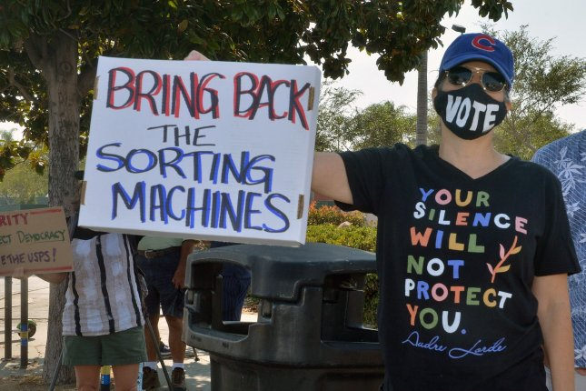 Activists rally against Postmaster General Louis DeJoy's service changes within the U.S. Postal Service ahead of the November general election at the Bicentennial Post Office in Los Angeles on August 25. Photo by Jim Ruymen/UPI
