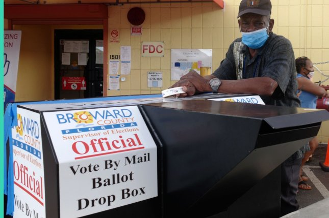Broward County, Fla., voters drive up to drop off their mail-in ballots at the Broward County Supervisor of Elections office in Lauderhill on Friday. Photo by Gary I Rothstein/UPI