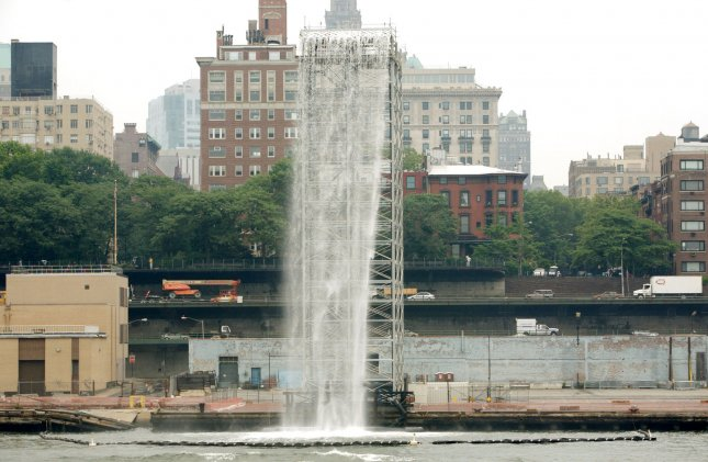 A 120-foot waterfall stands before the Brooklyn Promenade as the Broooklyn-Queens Expressway is seen behind it part which is part of the New York City Waterfalls installation, a series of man-made waterfalls situated along the East River on June 26, 2008 in New York. The four gigantic waterfalls made of steel frames is the work of Danish artist Olafur Eliasson and will be displayed until October 13. (UPI Photo/Monika Graff)