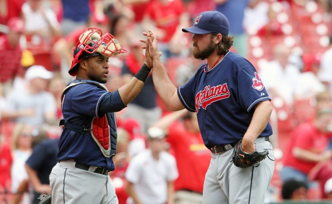 Cleveland Indians Carlos Santana (L) and pitcher Chris Perez celebrate their 4-1 win over the St. Louis Cardinals at Busch Stadium in St. Louis on June 10, 2012. UPI/Bill Greenblatt