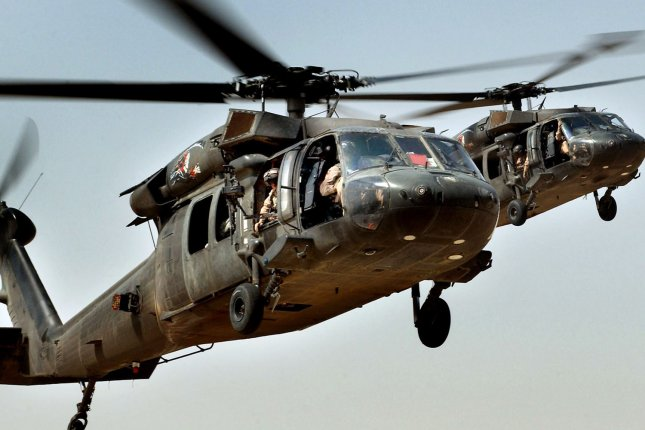 A UH-60 Black Hawk helicopter, similar to the ones pictured, crashed during a routine training mission in Fort Hood, Texas, killing all four crew members Monday afternoon. File Photo by Russell Lee Klika/Department of Defense