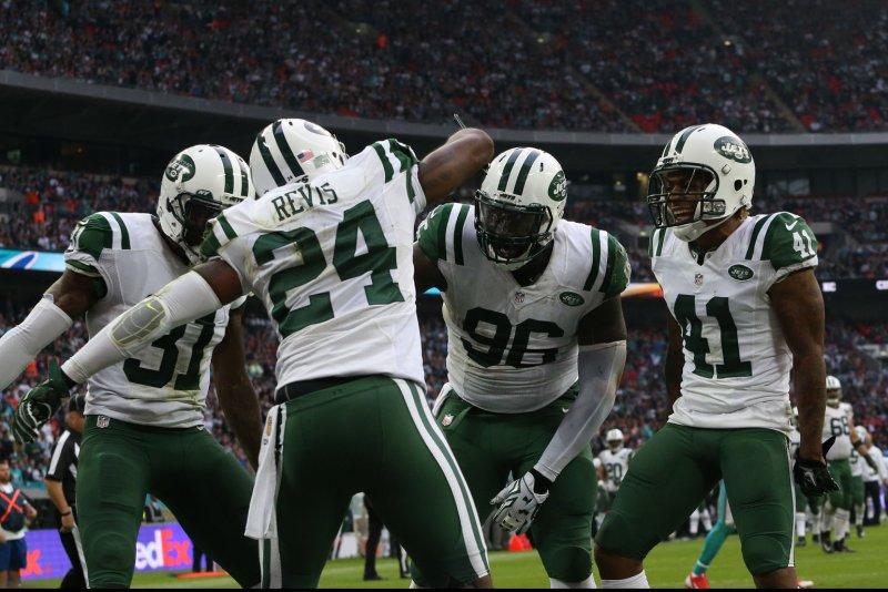New York Jets' Darrelle Revis celebrates an interception. Photo by Hugo Philpott/UPI.