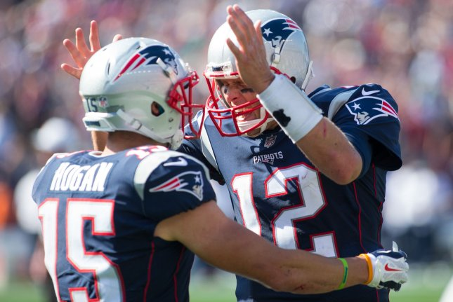 New England Patriots quarterback Tom Brady (12) celebrates with wide receiver Chris Hogan (15) after the two connected for a 47-yard touchdown in the second quarter against the Houston Texans at Gillette Stadium in Foxborough, Massachusetts on September 24, 2017. File photo by Matthew Healey/UPI