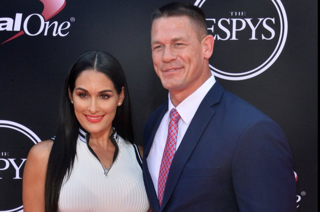 Nikki Bella (L) with John Cena. Bella is seen trying on multiple wedding dresses in a clip for an upcoming episode of Total Bellas. File Photo by Jim Ruymen/UPI
