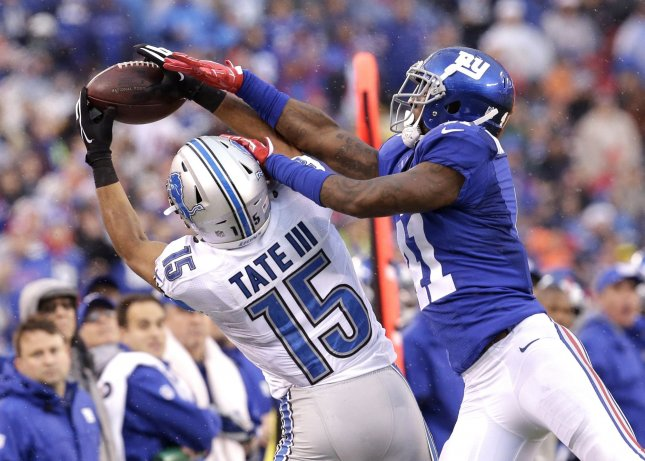 Former New York Giants defensive back Dominique Rodgers-Cromartie tries to pick off a pass in front of Detroit Lions receiver Golden Tate during a game in December 2016. Photo by John Angelillo/UPI