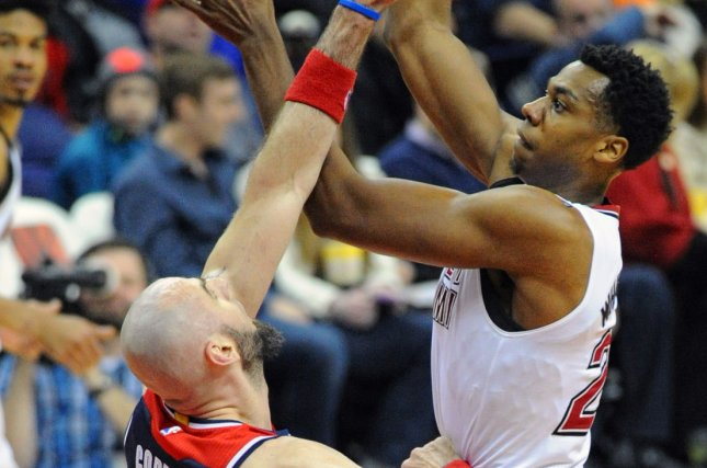 Hassan Whiteside (R) has agreed to a contract with the Sacramento Kings, the franchise that selected the center in the second round of the 2010 NBA Draft. File Photo by Mark Goldman/UPI