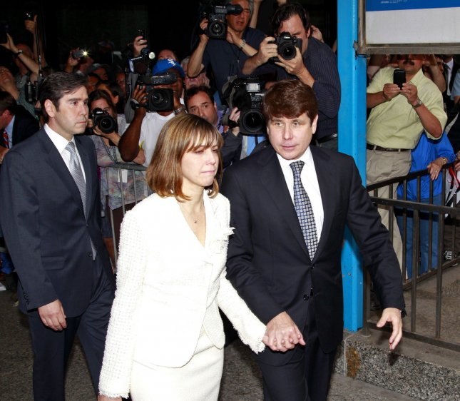 Former Illinois Gov. Rod Blagojevich, right, leaves with his wife Patricia, center, the federal court after hearing the verdict in his corruption trial on June 27, 2011 in Chicago. A federal jury found Blagojevich guilty on 17 of 20 charges Monday, including trying to peddle President Obama's vacant Senate seat. UPI/Kamil Krzaczynski