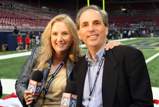 St. Louis Rams owners Chip Rosenbloom and sister Lucia Rodriguez pose for a photograph Sept. 12, 2008. The late Georgia Frontiere was honored before the game against the New York Giants. (UPI Photo/Bill Greenblatt).