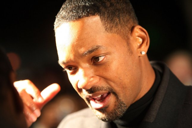 Actor Will Smith talks to reporters at the red carpet benefit screening of his new movie Seven Pounds in Creve Coeur, Missouri on November 19, 2008.