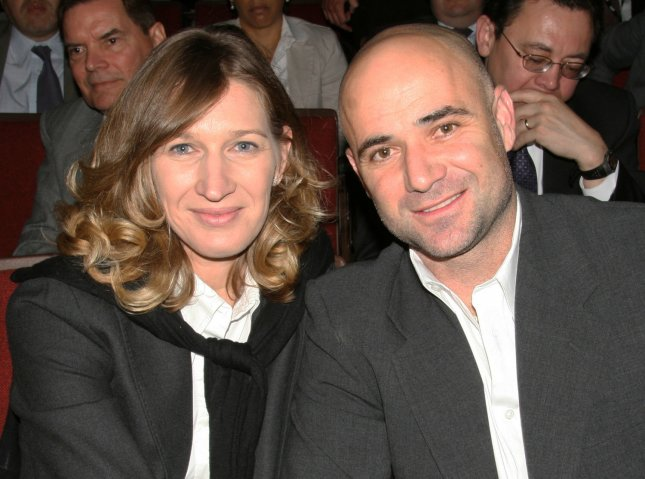 Steffi Graf and Andre Agassi, shown at a January 2008 event, will play a series of exhibition matches to test Wimbledon's new retractable roof over center court. (UPI Photo/Daniel Gluskoter)