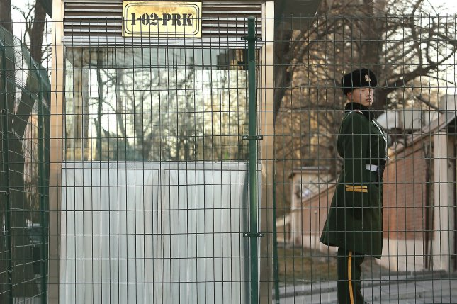 A Chinese soldier stands guard outside the North Korean embassy in Beijing. Relations between the countries have deteriorated after Pyongyang's multiple provocations. File Photo by Stephen Shaver/UPI