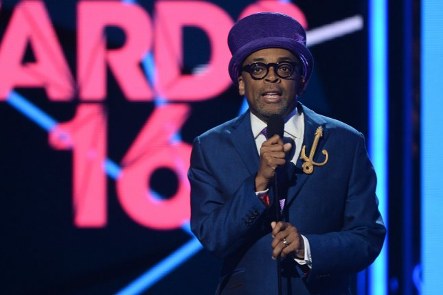 Director/producer Spike Lee (L) presents the Lifetime Achievement Award to honoree Samuel L. Jackson onstage during the 16th annual BET Awards at Microsoft Theater in Los Angeles on June 26, 2016. Lee's purple outfit was mocked on social media and compared to Willy Wonka. Photo by Jim Ruymen/UPI