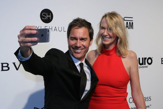 Eric McCormack (L) and wife Janet Holden attend the Elton John AIDS Foundation Academy Awards viewing party on February 26. The actor plays Will Truman on Will & Grace. File Photo by Howard Shen/UPI