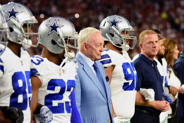 Dallas Cowboys' owner Jerry Jones (blue jacket) stands with his players before the national anthem before the Cowboys played the Arizona Cardinals on September 25 at University of Phoenix Stadium in Glendale, Ariz. Photo by Art Foxall/UPI