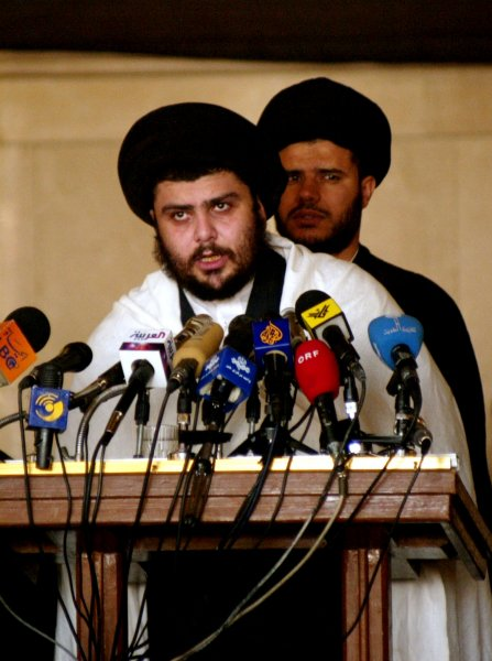 Radical Shiite Cleric and coalition fugitive Moqtada Sadr gives Friday prayers at a mosque in the small Iraqi town of Kufa on Aprile 23, 2004. Sadr threatened to launch suicide attacks if U.S. troops attack him and his forces in the holy city of Najaf. (UPI Photo/Mitch Prothero)