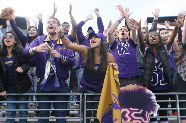 Washington Huskies fans cheer after a touchdown is scored in the second quarter against the Oregon State Beavers at Husky Stadium October 22, 2016 in Seattle. The Huskies beat the Beavers 41-17. Photo by Jim Bryant/UPI