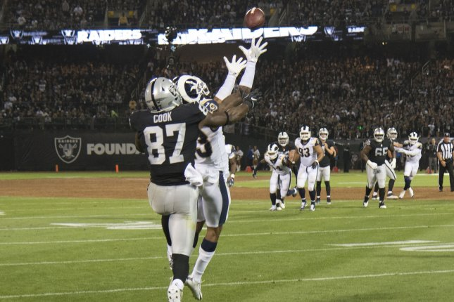 Los Angeles Rams SS John Johnson steps in front of Oakland Raiders tight end Jared Cook (87) to intercept a Derek Carr pass in the end zone in the second quarter on Monday at the Coliseum in Oakland. Photo by Terry Schmitt/UPI