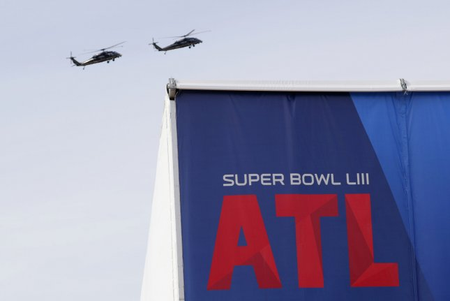 Black Hawk Helicopters circle Mercedes-Benz Stadium in Atlanta Wednesday ahead of Super Bowl LIII between Los Angeles and New England. Photo by John Angelillo/UPI