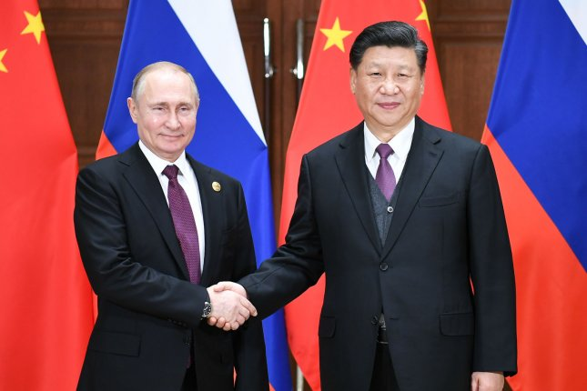 Russian President Vladimir Putin (L) shakes hands with Chinese President Xi Jinping during the Second Belt and Road Forum for International Cooperation in Beijing last April. File Pool Photo by Xie Huanchi/UPI