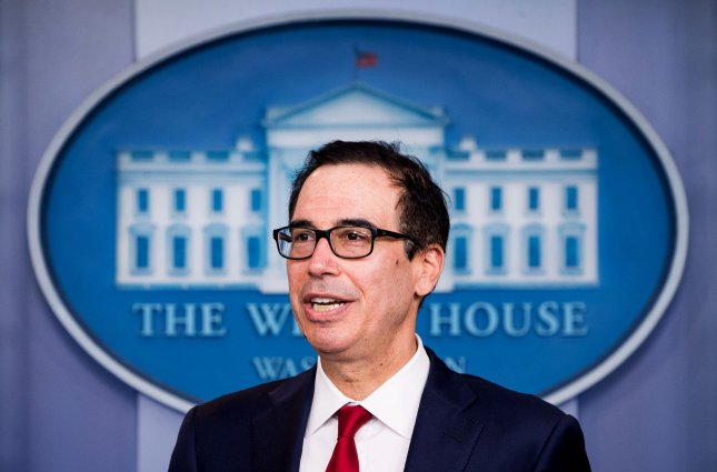 Treasury Secretary Steven Mnuchin imposed sanctions Wednesday against two Russian hackers accused of stealing millions of dollars worth of cryptocurrency through an elaborate phishing scheme. Photo by Kevin Dietsch/UPI