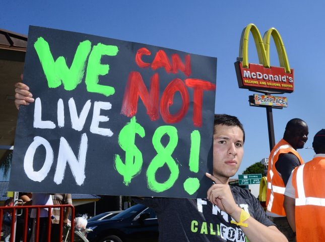 Fast food workers in the Los Angeles area began their first strike today, part of a nationwide attempt to raise the federal.minimum wage to $15 per hour and form a union. Organizers claim fast food workers are forced to rely on public assistance just to make ends meet.'' UPI/Jim Ruymen