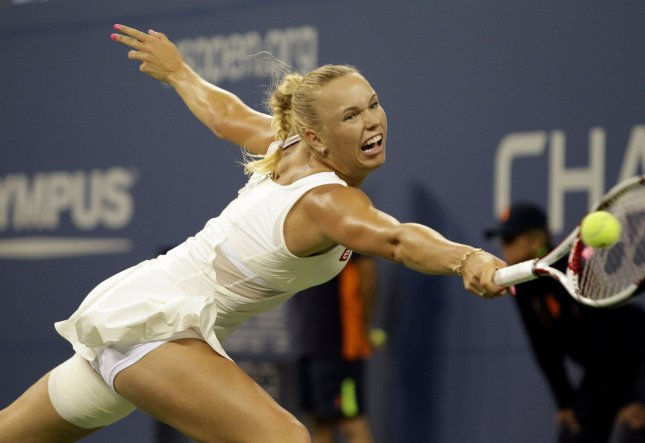 Caroline Wozniacki, shown at a 2011 tournament, dropped just two games Sunday in first-round play of the Apia International tennis torunament in Sydney. UPI/John Angelillo