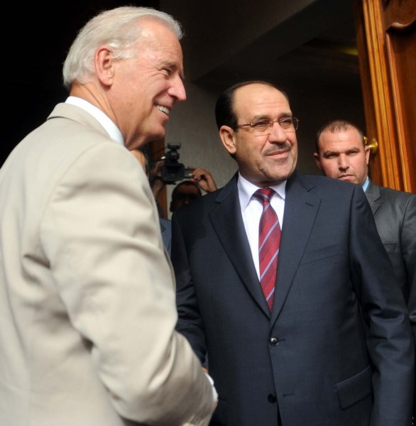 U.S. Vice President Joe Biden (L) shakes hands with Iraq's Prime Minister Nuri al-Maliki in Baghdad on July 4, 2010. UPI File Photo