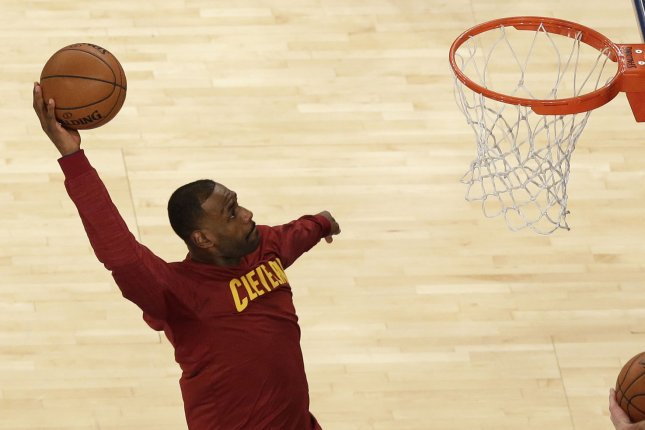 Cleveland Cavaliers' LeBron James dunks the basketball in practice. Photo by John Angelillo/UPI
