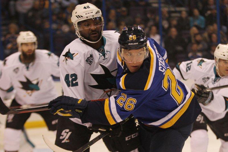 St. Louis Blues' Paul Stastny holds back San Jose Sharks' Joel Ward. Photo by Bill Greenblatt/UPI