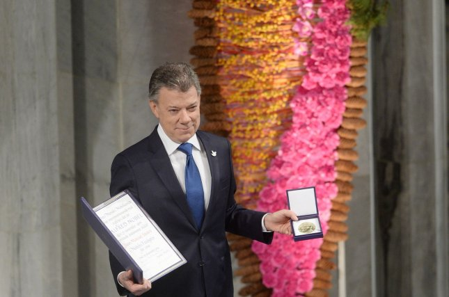 Colombian president Juan Manuel Santos holds the Nobel Peace Prize Award at City Hall in Oslo on December 10, 2016. Santos was awarded the 2016 Nobel Peace Prize for reaching an accord with Marxist rebels to end a 52-year civil war. Photo by Rune Hellestad/UPI