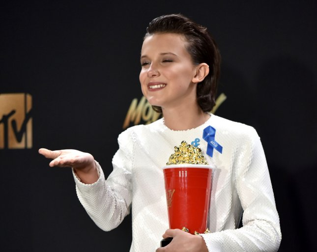 Actress Millie Bobby Brown appears backstage with the Best Actor in a Show award for her performance in Stranger Things during the MTV Movie & TV Awards Sunday at the Shrine Auditorium in Los Angeles. Photo by Christine Chew/UPI