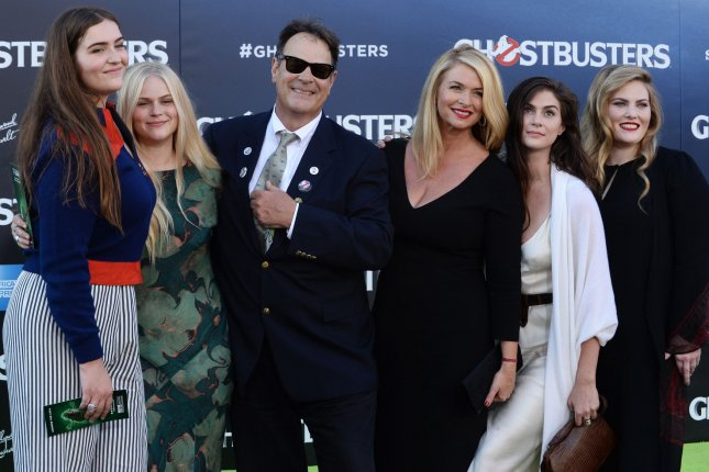 Dan Aykroyd and his wife Donna Dixon and family attend the premiere of Ghostbusters on July 9. In a new interview, Aykroyd says its director Paul Feig's fault that there won't be a sequel to 2016's Ghostbusters. File Photo by Jim Ruymen/UPI