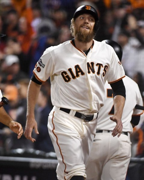 Hunter Pence and the San Francisco Giants rocked the Pittsburgh Pirates on Friday. Photo by Terry Schmitt/UPI