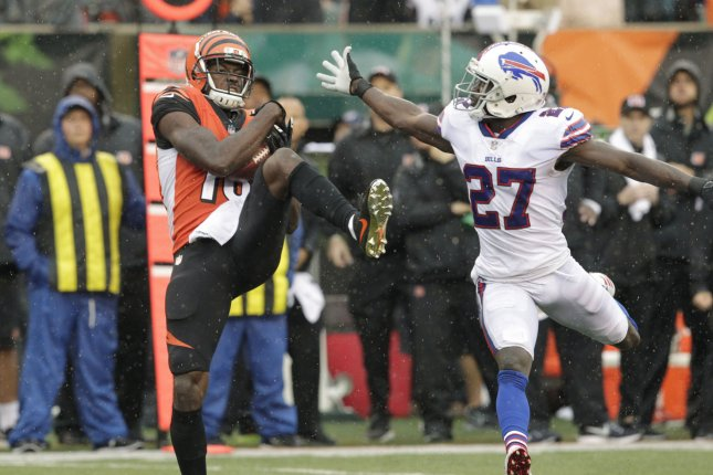 Cincinnati Bengals wide receiver A.J. Green (18) makes the catch under pressure from Buffalo Bills' Tre Davis White (27) during the second half of play at Paul Brown Stadium in Cincinnati, Ohio, October 8, 2017. File photo by John Sommers II/UPI