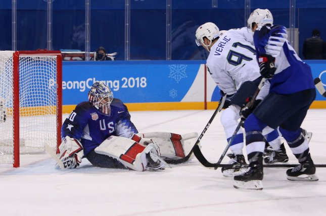Goaltender Ryan Zapolski of the USA blocks a shot from Miha Verlic (91) of Slovenia during the men's ice hockey preliminary round - Group B game between the USA and Slovenia on Wednesday at the Kwandong Hockey Center in Gangneung, South Korea during the 2018 Pyeongchang Winter Olympics. Photo by Andrew Wong/UPI