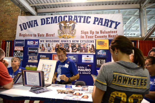 The Iowa Democratic Party booth provides information on candidates Saturday at the Iowa State Fair in Des Moines, Iowa. Photo by Mike Theiler/UPI