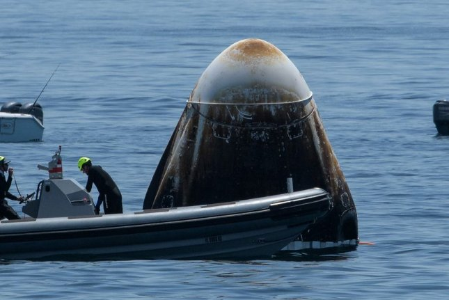 The Crew Dragon spacecraft Endeavor, which is scheduled for another flight on April 22, floats in the Gulf of Mexico on August 2 after the historic first flight of astronauts on a SpaceX mission. File Photo by Bill Ingalls/NASA