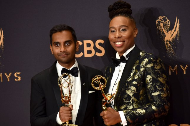 Writers Aziz Ansari (L) and Lena Waithe, winners of the Outstanding Writing for a Comedy Series award for Master of None, appear backstage during the Emmy Awards on September 17, 2017. File Photo by Christine Chew/UPI