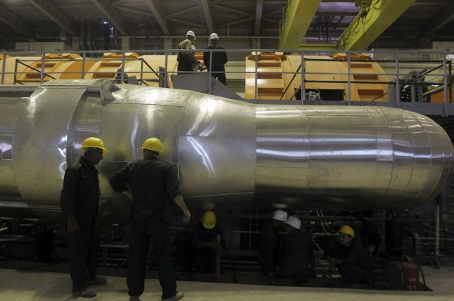Workers continue their duties at the Bushehr nuclear power plant on October 26, 2010 as Iran began to load fuel into the core of its first atomic power plant some 745 miles south of Tehran. UPI/Mehr News Agency/Majid Asgarpour