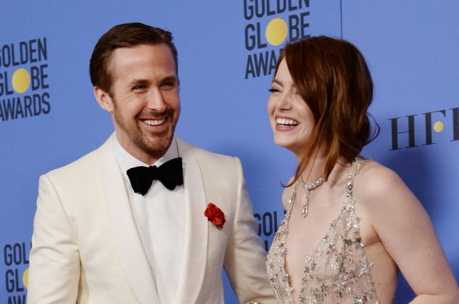 Ryan Gosling and Emma Stone, winners of the awards for Best Performance by an Actor and Actress in a Motion Picture Musical or Comedy respectively for La La Land, appear backstage with their trophies during the 74th annual Golden Globe Awards in Beverly Hills on January 8, 2017. Photo by Jim Ruymen/UPI