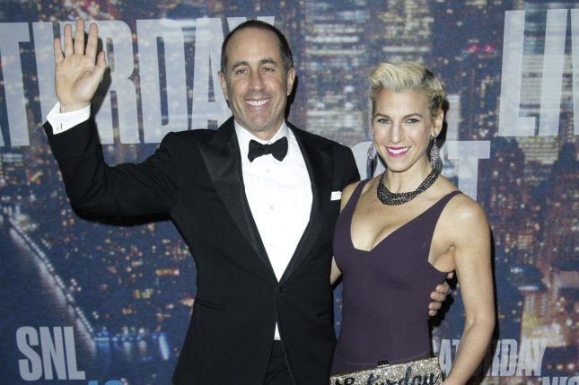Jerry Seinfeld (L) and Jessica Seinfeld arrive on the red carpet at the SNL 40th Anniversary Special on February 15, 2015. Seinfeld is seen unwilling to give singer Kesha a hug during a taped interview. File Photo by John Angelillo/UPI