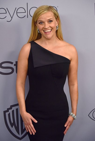 Reese Witherspoon's one-shoulder Zac Posen gown will be put up for sale beginning Friday. File Photo by Christine Chew/UPI