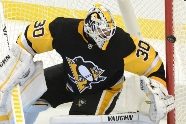 Pittsburgh Penguins goaltender Matt Murray (30) watches as a shot flies past the goal during the third period on October 4, 2018 at PPG Paints Arena in Pittsburgh. Photo by Archie Carpenter/UPI