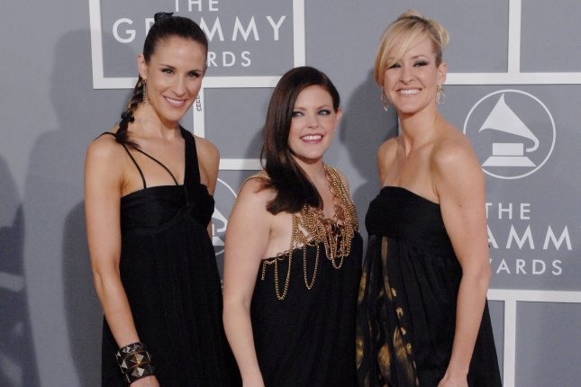 The Dixie Chicks, composed of Emily Robinson, Natalie Maines and Martie Maguire, from left to right, unveiled a new name, The Chicks, and released the new song March March. File Photo by Jim Ruymen/UPI